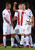 Robert Lewandowski of Poland celebrates with his team mates after scoring the equalising goal in the final minute of the game during the EURO 2016...