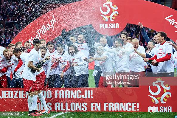 Robert Lewandowski of Poland celebrates with team mates after the UEFA EURO 2016 qualifying match between Poland and Republic of Ireland at National...