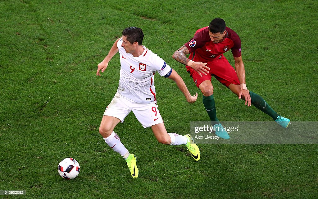 <a gi-track='captionPersonalityLinkClicked' href=/galleries/search?phrase=Robert+Lewandowski&family=editorial&specificpeople=5532633 ng-click='$event.stopPropagation()'>Robert Lewandowski</a> of Poland controls the ball under pressure of Jose Fonte of Portugal during the UEFA EURO 2016 quarter final match between Poland and Portugal at Stade Velodrome on June 30, 2016 in Marseille, France.