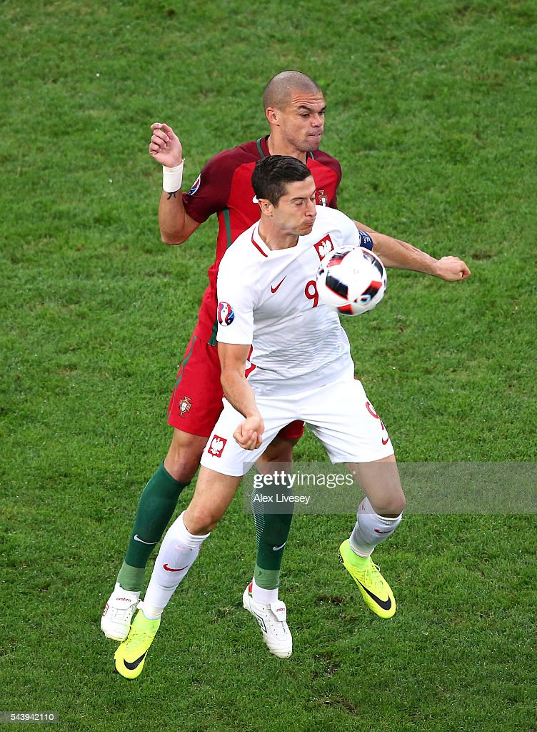 <a gi-track='captionPersonalityLinkClicked' href=/galleries/search?phrase=Robert+Lewandowski&family=editorial&specificpeople=5532633 ng-click='$event.stopPropagation()'>Robert Lewandowski</a> of Poland controls the ball under pressure of <a gi-track='captionPersonalityLinkClicked' href=/galleries/search?phrase=Pepe+-+Portuguese+Soccer+Player&family=editorial&specificpeople=4401229 ng-click='$event.stopPropagation()'>Pepe</a> of Portugal during the UEFA EURO 2016 quarter final match between Poland and Portugal at Stade Velodrome on June 30, 2016 in Marseille, France.