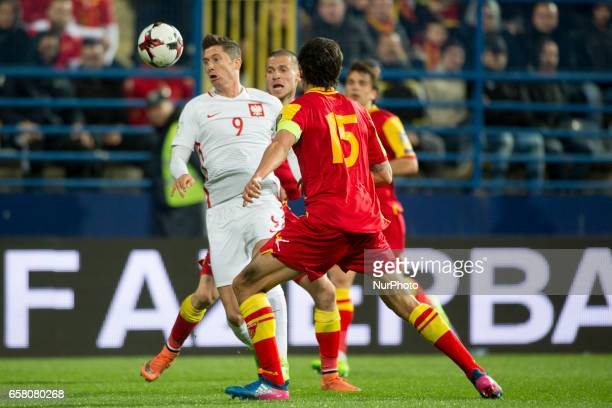 Robert Lewandowski of Poland fights for the ball with Stefan Savic of Montenegro during the FIFA World Cup 2018 Qualifying Round Group E match...
