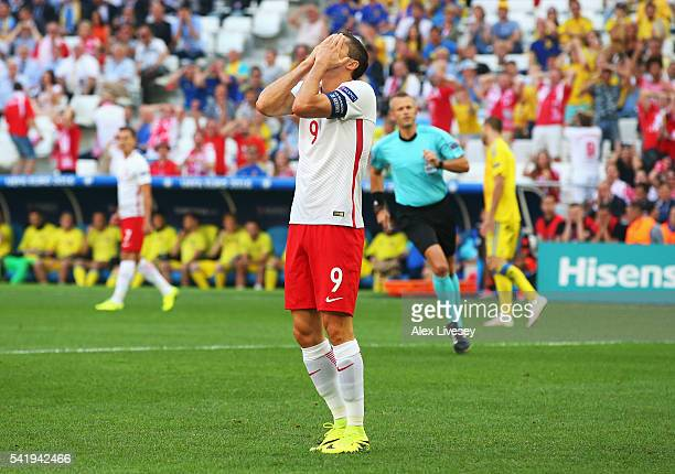 Robert Lewandowski of Poland holds his face in despair after missing a chance during the UEFA EURO 2016 Group C match between Ukraine and Poland at...
