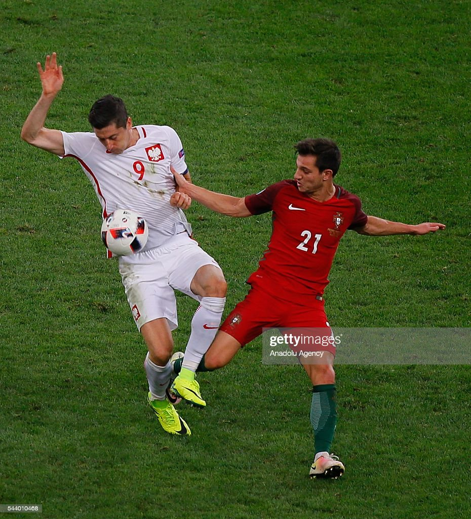 Robert Lewandowski (9) of Poland in action against Cedric (21) of Portugal during the Euro 2016 quarter-final football match between Poland and Portugal at the Stade Velodrome in Marseille, France on June 30, 2016.