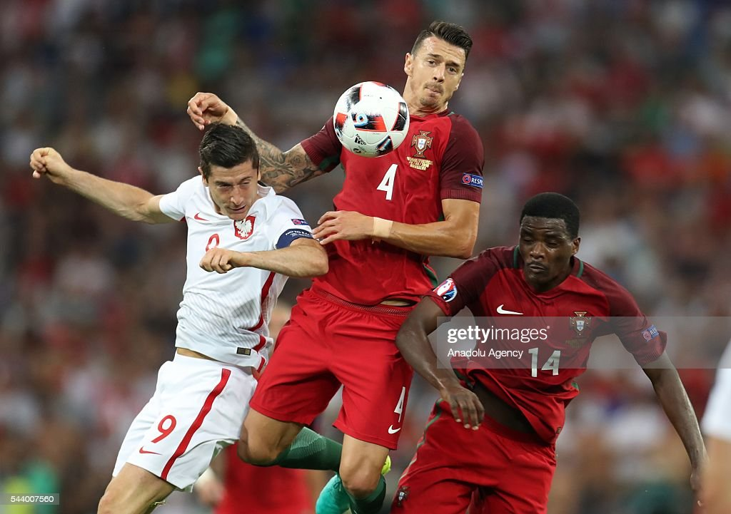 Robert Lewandowski (L) of Poland in action against José Fonte (C) of Portugal during the Euro 2016 quarter-final football match between Poland and Portugal at the Stade Velodrome in Marseille, France on June 30, 2016.