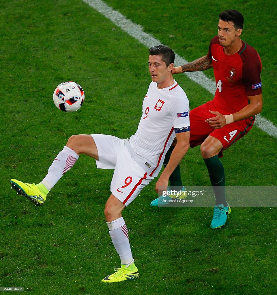 Robert Lewandowski (9) of Poland in action against Josee Fonte of Portugal (4) during the Euro 2016 quarter-final football match between Poland and Portugal at the Stade Velodrome in Marseille, France on June 30, 2016.