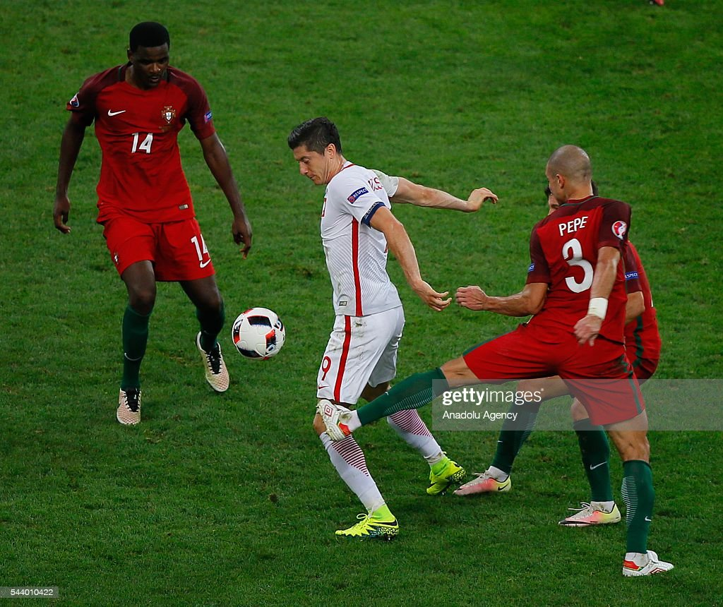 Robert Lewandowski of Poland (C) in action against William Carvalho (14) and Pepe (3) of Portugal during the Euro 2016 quarter-final football match between Poland and Portugal at the Stade Velodrome in Marseille, France on June 30, 2016.
