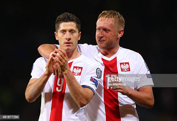 Robert Lewandowski of Poland is congratulated by team mate Kamil Glik of Poland after he scores a late equaliser during the UEFA EURO 2016 qualifier...