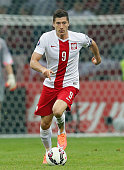 Robert Lewandowski of Poland runs with the ball during the EURO 2016 Group D qualifying match between Poland and Germany at the National Stadium on...