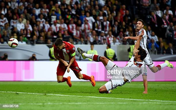 Robert Lewandowski of Poland scores his team's opening goal with a header during the EURO 2016 Qualifier Group D match between Germany and Poland at...