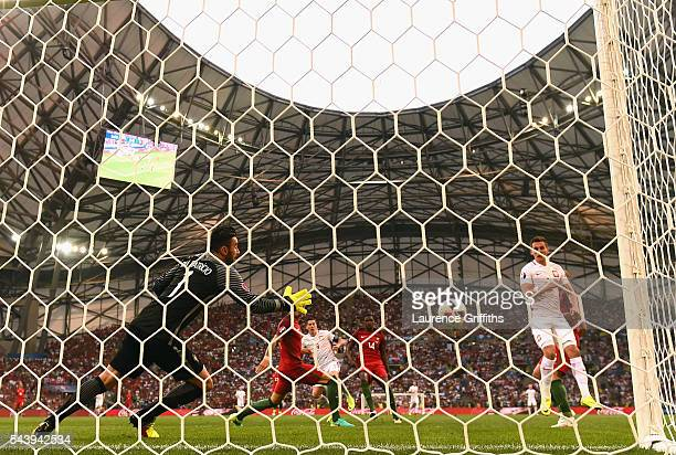 Robert Lewandowski of Poland scores the opening goal past Rui Patricio of Portugal during the UEFA EURO 2016 quarter final match between Poland and...