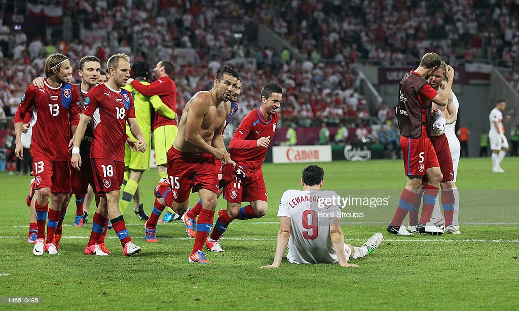 <a gi-track='captionPersonalityLinkClicked' href=/galleries/search?phrase=Robert+Lewandowski&family=editorial&specificpeople=5532633 ng-click='$event.stopPropagation()'>Robert Lewandowski</a> (C) of Poland shows his frustration as players of Czech Republic celebrate victory and qualification to the Quarter-Finals after the UEFA EURO 2012 group A match between Czech Republic and Poland at The Municipal Stadium on June 16, 2012 in Wroclaw, Poland.