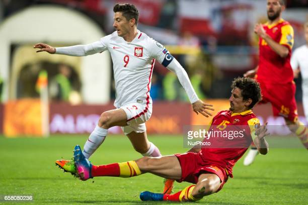 Robert Lewandowski of Poland tackled by stefan Savic of Montenegro during the FIFA World Cup 2018 Qualifying Round Group E match between Montenegro...