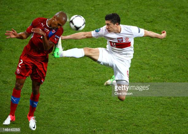 Robert Lewandowski of Poland tackles Theodor Gebre Selassie of Czech Republic during the UEFA EURO 2012 group A match between Czech Republic and...
