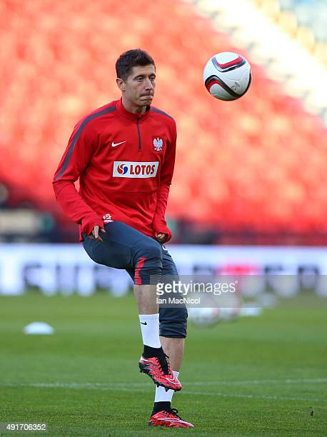 Robert Lewandowski of Poland takes part in a training session ahead of their UEFA EURO 2016 qualifier against Scotland at Hampden Park on October 07...