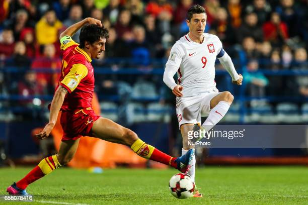 Robert Lewandowski of Poland vies Stefan Savic of Montenegro during the FIFA World Cup 2018 qualification football match between Montenegro and...