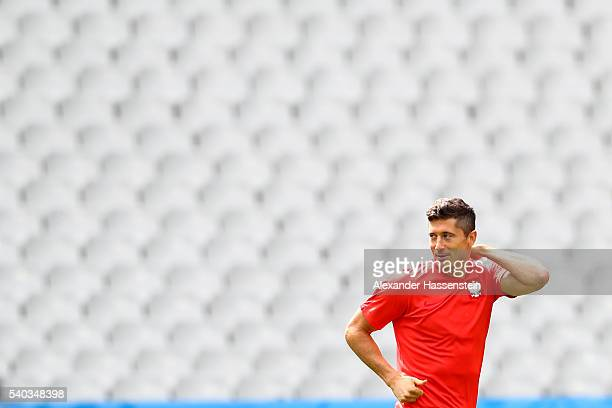 Robert Lewandowski of Poland warms up during a team Poland training session ahead of the UEFA EURO 2016 Group C match between Germany and Poland at...