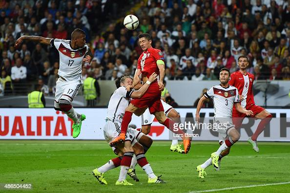 Robert Lewandowski of Poland wins a header challenged by Bastian Schweinsteiger and Jerome Boateng of Germany during the EURO 2016 Qualifier Group D...