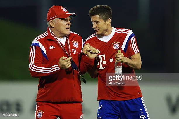 Robert Lewandowski pushes assistant coach Hermann Gerland during day 8 of the Bayern Muenchen training camp at ASPIRE Academy for Sports Excellence...