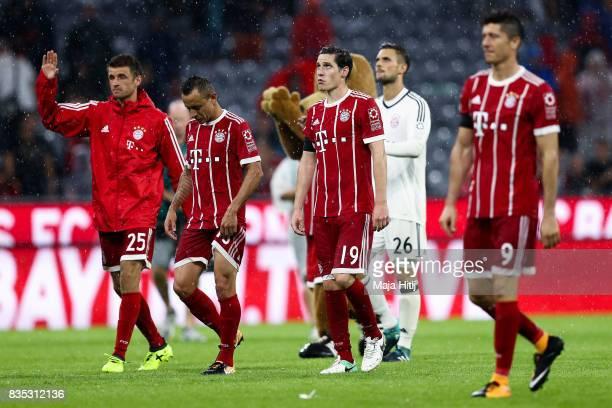 Robert Lewandowski Sebastian Rudy Rafinha and Thomas Mueller of Bayern reacts after the Bundesliga match between FC Bayern Muenchen and Bayer 04...