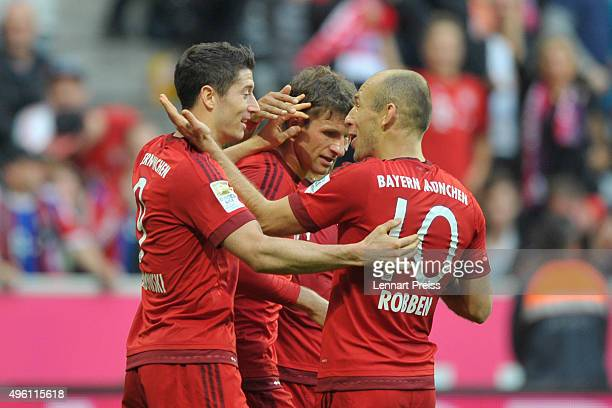 Robert Lewandowski Thomas Mueller and Arjen Robben of Bayern Muenchen celebrathe their side's third goal during the Bundesliga match between FC...
