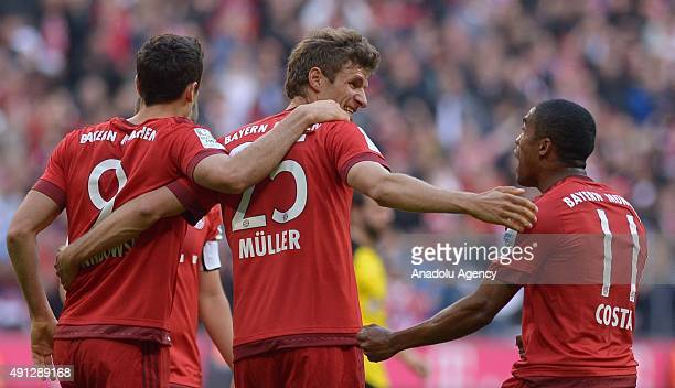 Robert Lewandowski Thomas Mueller and Douglas Costa of Bayern Munich celebrate the 10 during the Bundesliga soccer match between FC Bayern Munich and...