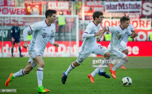 Robert Lewandowski Thomas Mueller and Joshua Kimmich of Bayern Munich with Ball during the Bundesliga match between FC Ingolstadt 04 and Bayern...