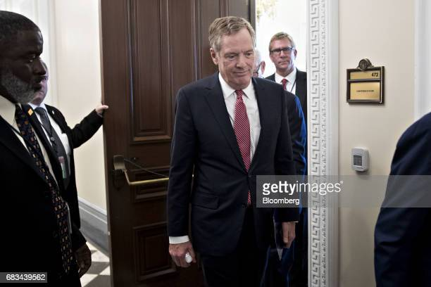Robert Lighthizer US trade representative exits from a conference room before a swearing in ceremony at the Eisenhower Executive Office Building in...