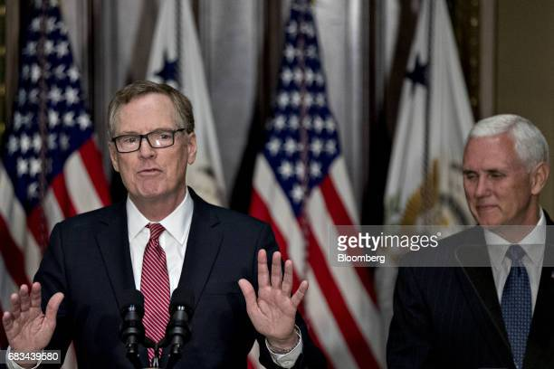 Robert Lighthizer US trade representative speaks after being sworn in by US Vice President Mike Pence right during a ceremony in the Indian Treaty...