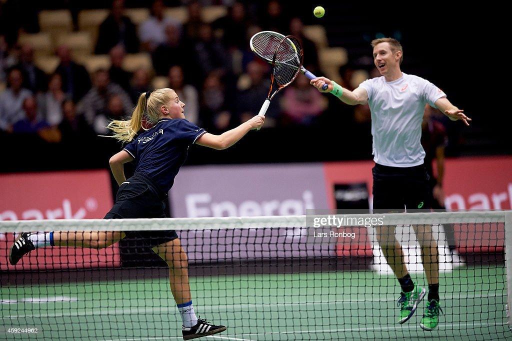 Robert Lindstedt of Sweden plays with a ball girl instead of Frederik Loechte Nielsen of Denmark during the Energi Danmark Champions Battle at Jyske...