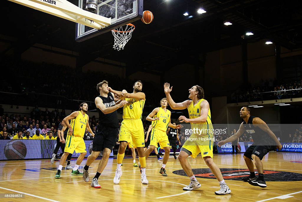 Robert Loe of the Tall Blacks, Andrew Bogut and Cameron Bairstow (R) of the Boomers compete for the ball during the game two match between the New Zealand Tall Blacks and Australian Boomers at at TSB Bank Arena on August 18, 2015 in Wellington, New Zealand.