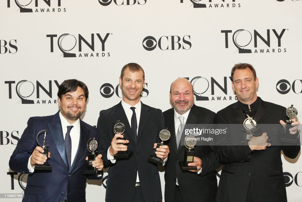 Robert Lopez, Matt Stone, Casey Nicholaw and Trey Parker pose with the award for Best Musical in the press room during the 65th Annual Tony Awards at the The Jewish Community Center in Manhattan on June 12, 2011 in New York City.
