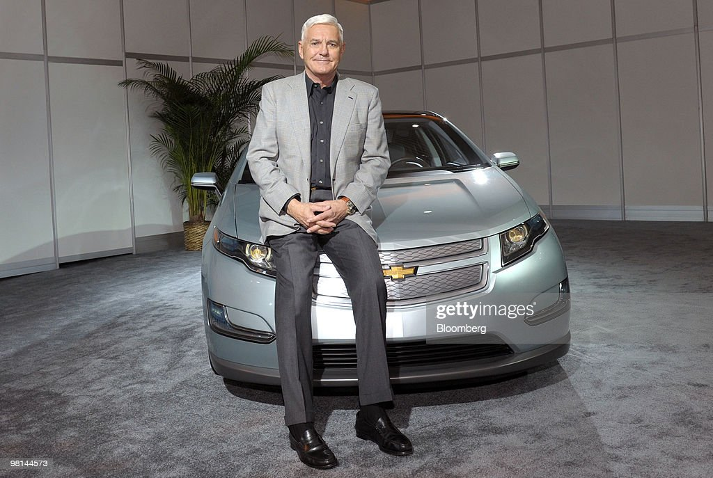 Robert Lutz, vice chairman of General Motors Co., poses with the Chevrolet Volt, a plug-in hybrid due out later this year, in New York, U.S., on Tuesday, March 30, 2010. The Volt can travel 40 miles (64 kilometers) solely on lithium-ion battery power, according to GM. After the batteries run down, an onboard gasoline engine recharges the cells, extending the car's driving range. Photographer: Peter Foley/Bloomberg via Getty Images
