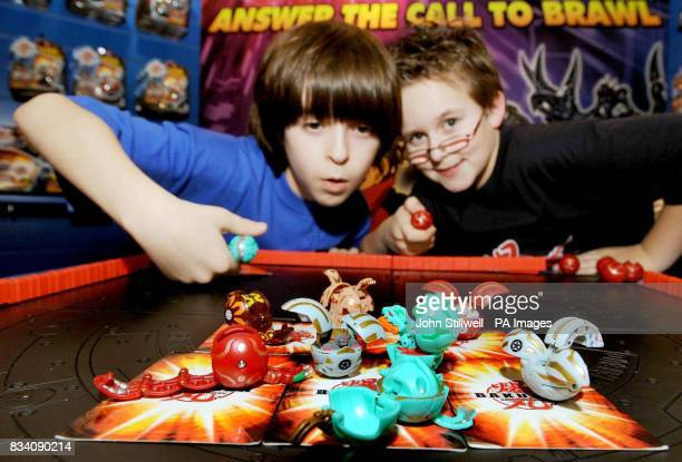 Robert Madge and Jake Pratt play a game of Bakugan a game that's predicted to be a big hit for boys later this year at the 2008 Toy Fair at ExCel...