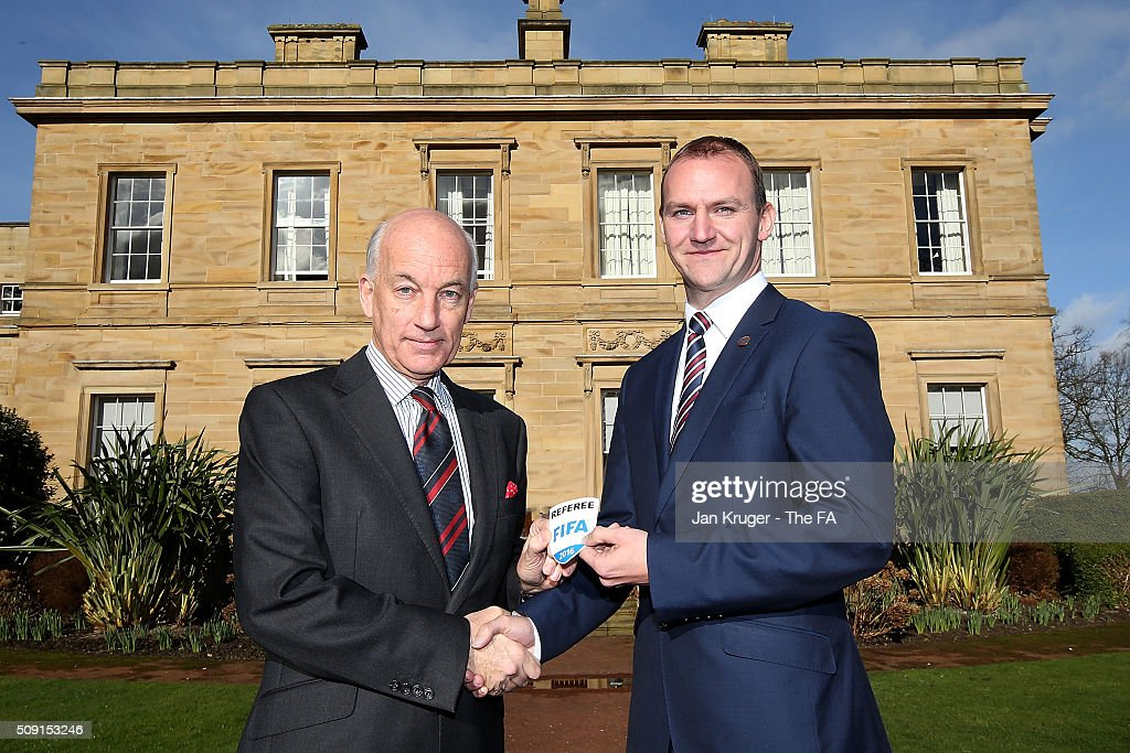 Robert Madley (R) receives his FIFA Referee badge from David Elleray during the FIFA Referees meeting 2016 at Oulton Hall on February 9, 2016 in Leeds, England.