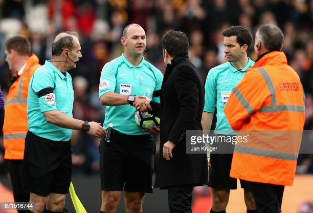 Robert Madley speaks with Marco Silva Manager of Hull City following the full time whistle during the Premier League match between Hull City and...