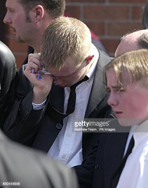 Robert Mahood wipes away tears as his younger brother David stands close by before the funeral of their father Bobby in Belfast Several hundred...