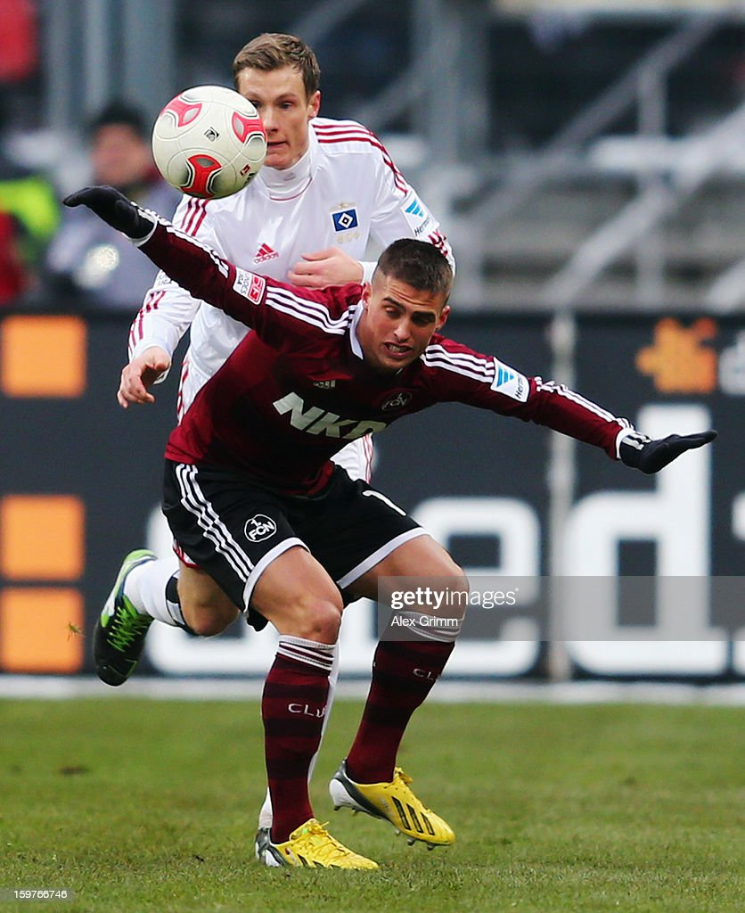 Robert Mak (front) of Nuernberg is challenged by Marcell Jansen of Hamburg during the Bundesliga match between 1. FC Nuernberg and Hamburger SV at Easy Credit Stadium on January 20, 2013 in Nuremberg, Germany.