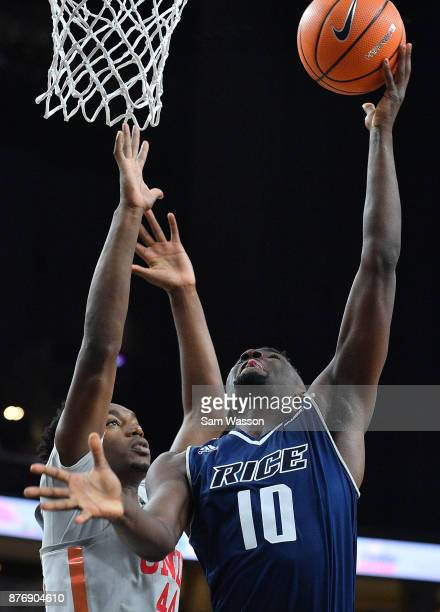 Robert Martin of the Rice Owls goes in for a layup against Brandon McCoy of the UNLV Rebels during day one of the Main Event basketball tournament at...