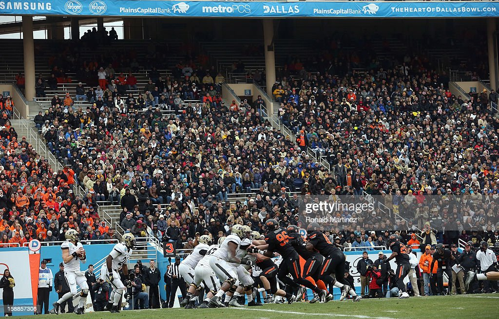 Robert Marve #9 of the Purdue Boilermakers passes against the Oklahoma State Cowboys during the Heart of Dallas Bowl at Cotton Bowl on January 1, 2013 in Dallas, Texas.