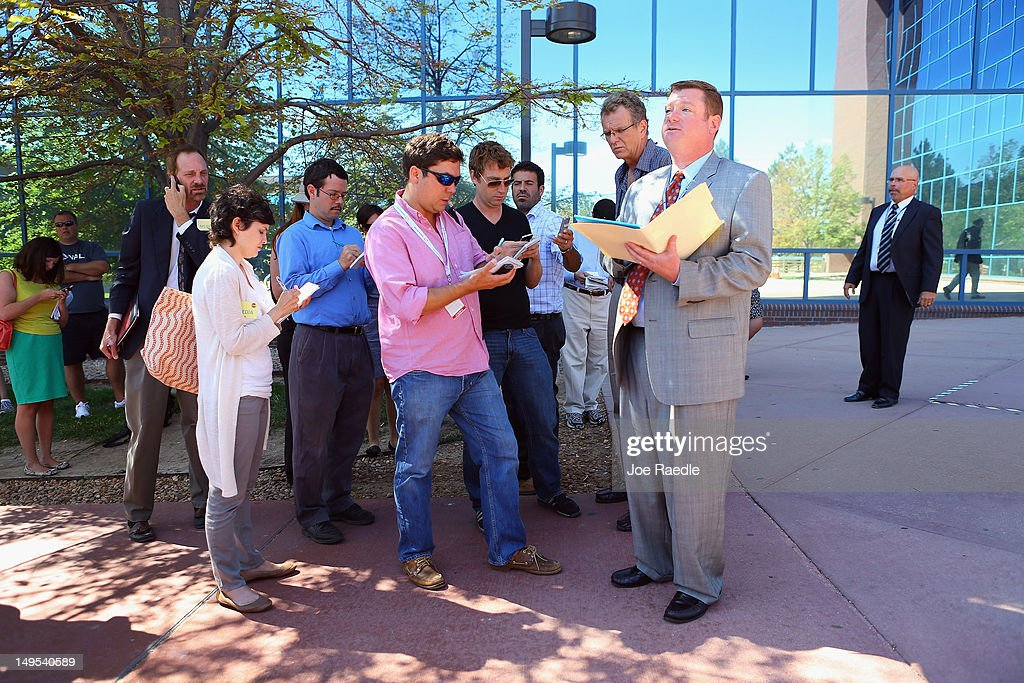 Robert McCallum, a spokesman for the courts, briefs the media in front of the Arapahoe County Courthouse where the arraignment hearing for suspect James Holmes was held on July 30, 2012 in Centennial, Colorado. James Holmes, 24, who is accused of killing 12 people and injuring 58 in a shooting spree July 20, during a screening of 'The Dark Knight Rises.' in Aurora, Colorado was charged with 24 counts of first-degree murder and 116 counts of attempted murder.