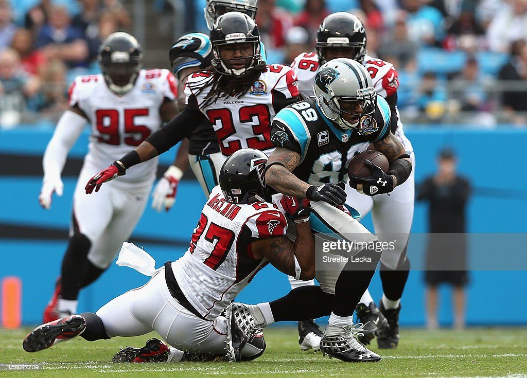 Robert McClain #27 of the Atlanta Falcons tries to tackle Steve Smith #89 of the Carolina Panthers during their game at Bank of America Stadium on December 9, 2012 in Charlotte, North Carolina.
