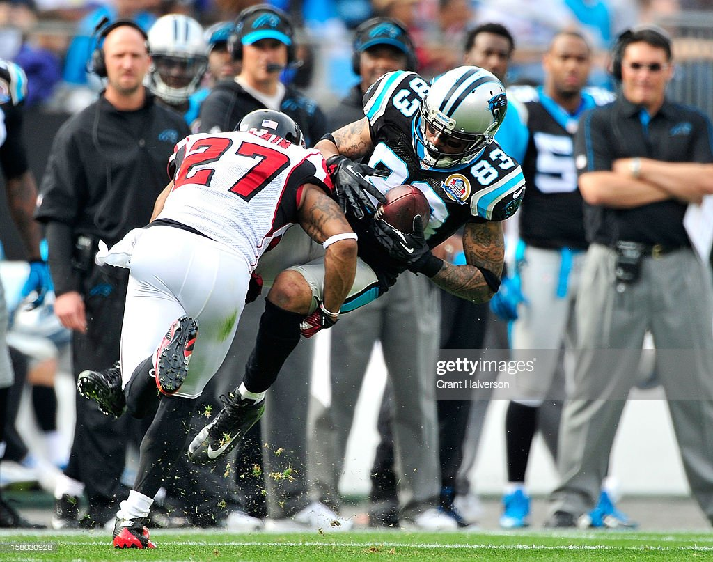 Robert McClain #27 of the Atlanta Falcons upends Louis Murphy #83 of the Carolina Panthers during play at Bank of America Stadium on December 9, 2012 in Charlotte, North Carolina.