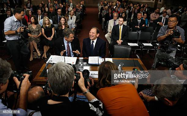 Robert McDonald President Obama's nominee to be the Secretary of Veterans Affairs laughs while talking with Sen Sherrod Brown prior to McDonald's...