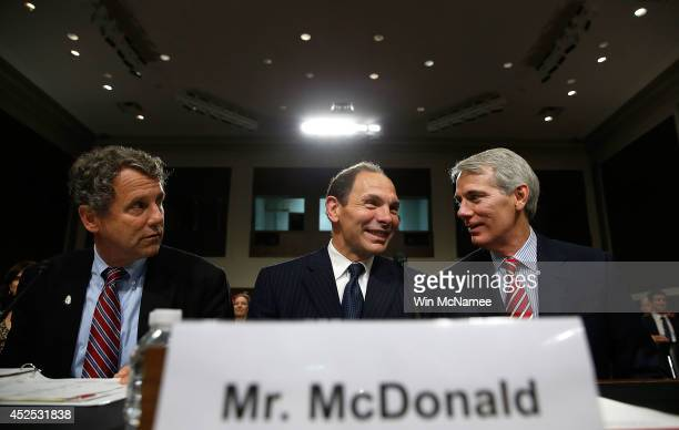 Robert McDonald President Obama's nominee to be the Secretary of Veterans Affairs confers with Sen Sherrod Brown and Sen Rob Portman prior to...