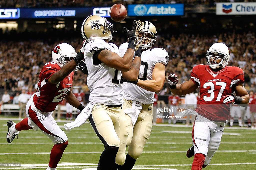 Robert Meachem #17 of the New Orleans Saints catches a touchdown pass over Jerraud Powers #25 of the Arizona Cardinals at the Mercedes-Benz Superdome on September 22, 2013 in New Orleans, Louisiana.