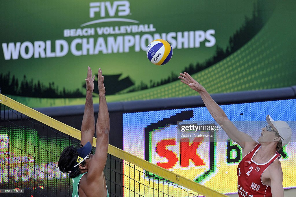 Robert Meeuwsen (R) of the Netherlands attacks against Ricardo Alex Costa Santos (L) of Brazil during the men's final match between the Netherlands and Brazil during Day 7 of the FIVB World Championships on July 7, 2013 in Stare Jablonki, Poland.