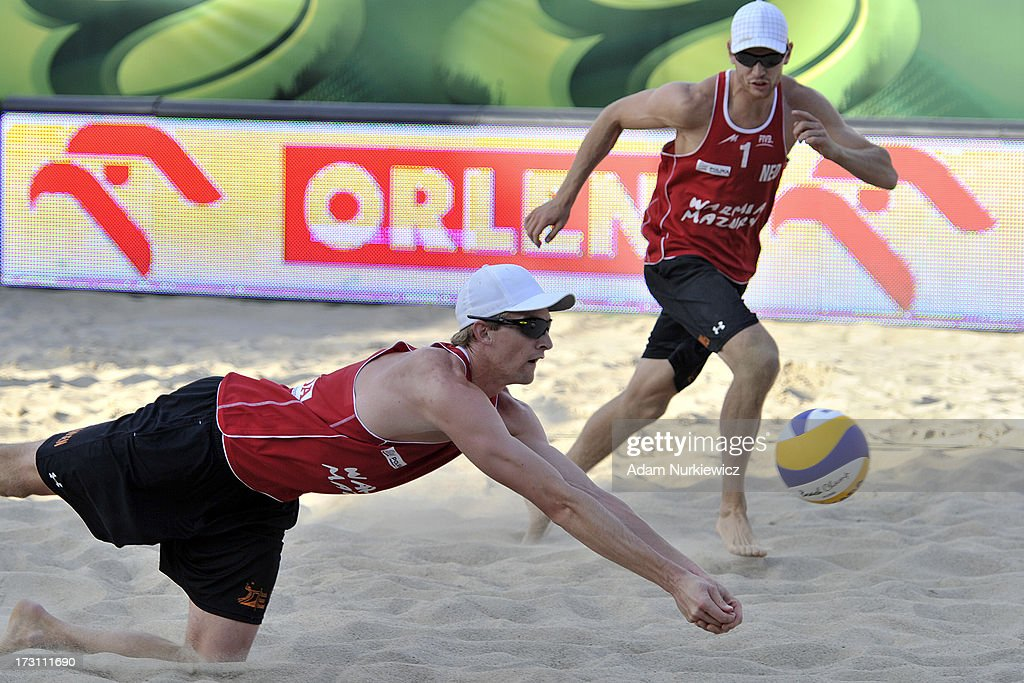 Robert Meeuwsen (L) of the Netherlands saves the ball during the men's final match between the Netherlands and Brazil during Day 7 of the FIVB World Championships on July 7, 2013 in Stare Jablonki, Poland.