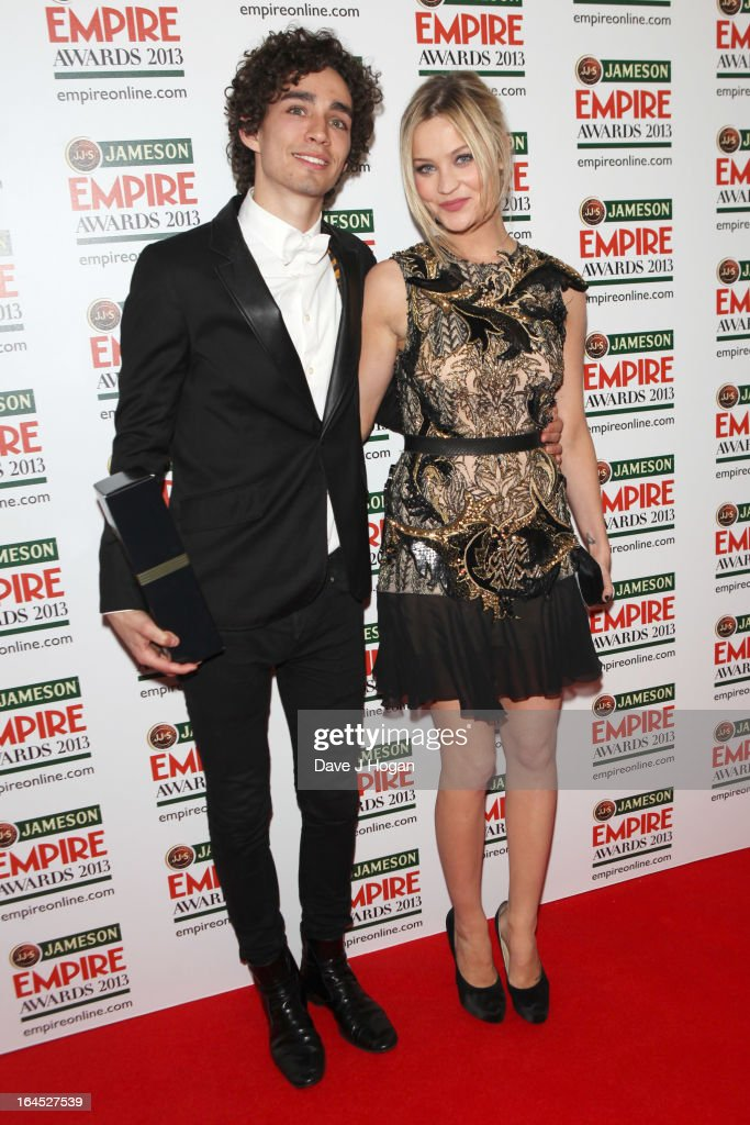 Robert Michael Sheehan and Laura Whitmore pose in the press room at the Jameson Empire Awards 2013 at Grosvenor House Hotel on March 24, 2013 in London, England.
