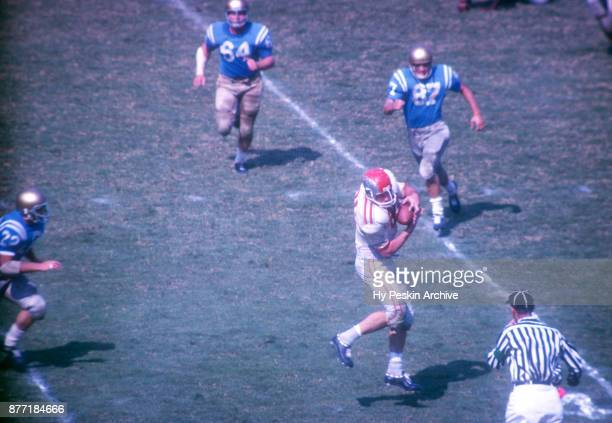 Robert Middleton of the Ohio State Buckeyes makes the catch during an NCAA game against the UCLA Bruins on October 6 1962 at the Los Angeles Memorial...