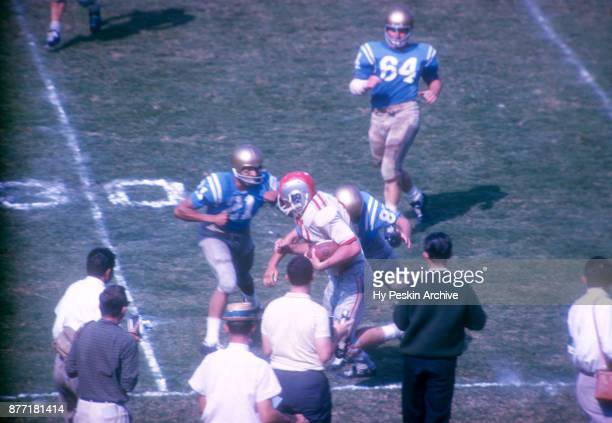 Robert Middleton of the Ohio State Buckeyes runs with the ball as he is knocked out of bounds by the UCLA Bruins during an NCAA game on October 6...